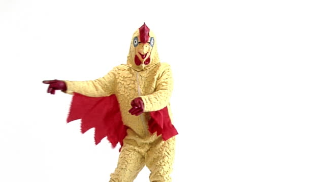 Dancing Chicken Cheesy chicken mascot fooling and dancing around. mask disguise stock videos & royalty-free footage