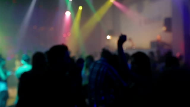 Dancing crowd people with hands in disco video