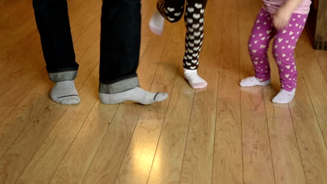 Dancing feet Father and daughter dancing away in the living room sock stock videos & royalty-free footage