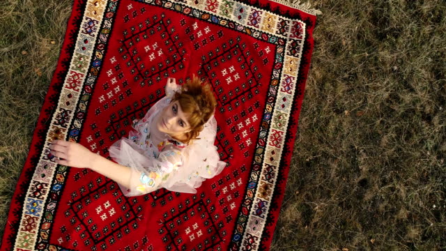 Dancing from heart Beautiful girl lying on a kilim,playing with her hands hippie stock videos & royalty-free footage
