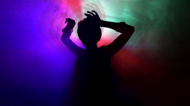dancing girl in a night club dancing girl in a night club with laser on a background, moving in slow mo silhouette people stock videos & royalty-free footage