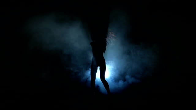 Dancing girl silhouette. Slow motion. video