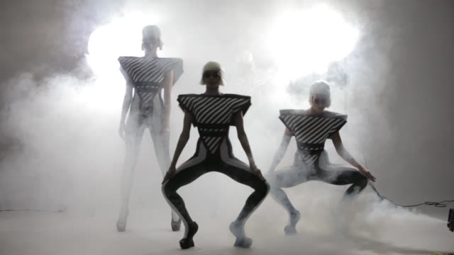Dancing girls in a smoke on a white background Dancing girls in a smoke on a white background HD organized group stock videos & royalty-free footage