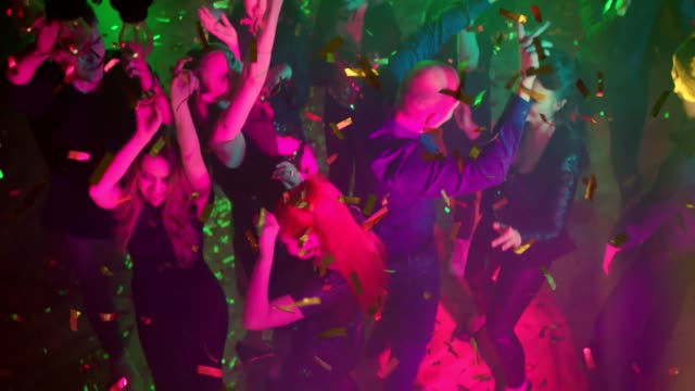dancing in a nightclub. high angle shot - office party stock videos and b-roll footage