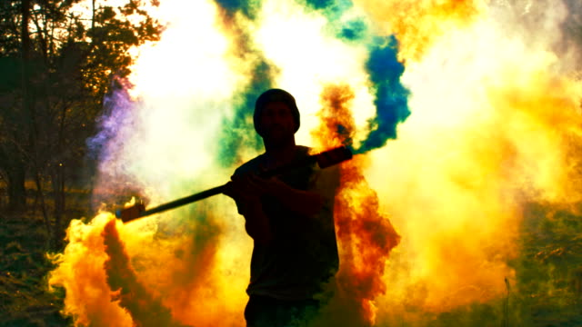 Dancing in colored smoke Man playing with smoke bombs silhouette people stock videos & royalty-free footage