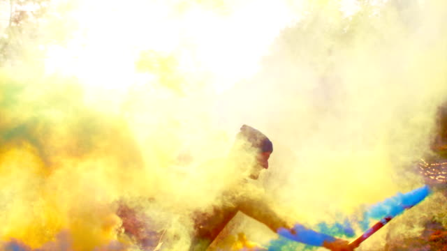 Dancing in colored smoke Man playing with smoke bombs explosive stock videos & royalty-free footage
