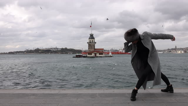 Dancing in front of maiden's tower view in Istanbul city