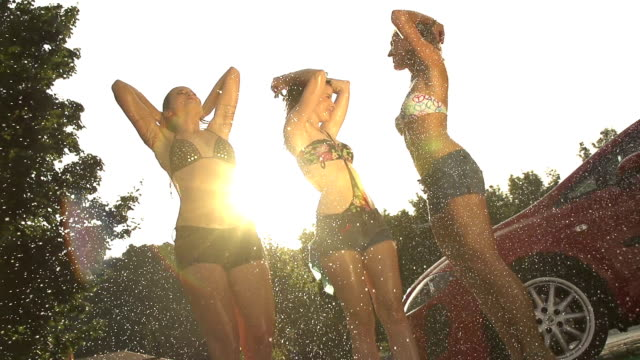 SLOW MOTION: Dancing in the rain SLOW MOTION: Dancing in the rain seductive women stock videos & royalty-free footage