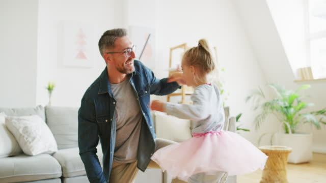 Dancing is her favorite thing to do 4k video footage of a father and daughter dancing together at home royalty stock videos & royalty-free footage