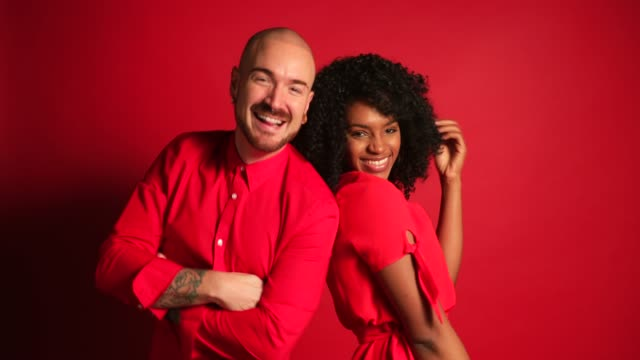 Dancing Partners Two adult friends dancing infront of a red background in a studio. background color stock videos & royalty-free footage
