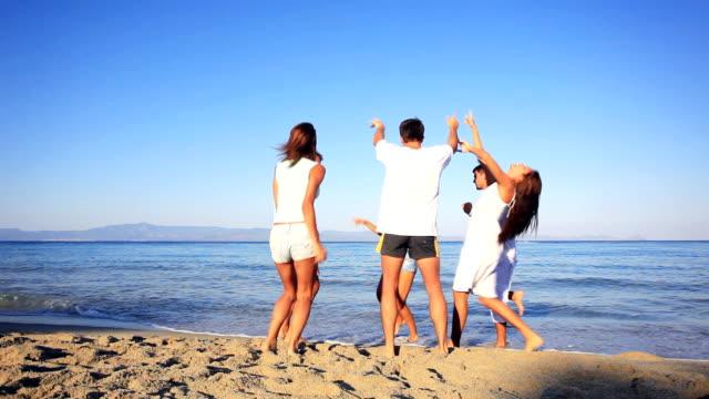 Dancing people against the sea. video