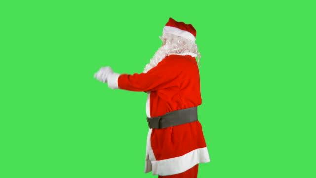 hd time-lapse: dancing santa claus - orta plan plan türleri stok videoları ve detay görüntü çekimi
