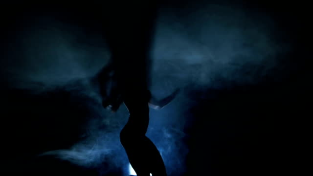 Dancing silhouettes of woman in a nightclub video