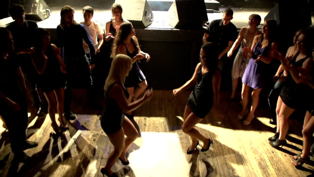 Dancing to music in a nightclub video