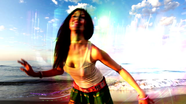 dancing woman young woman dances on a beach at sunrise, shot with canon 5d mk2, barcelona, spain hippie stock videos & royalty-free footage