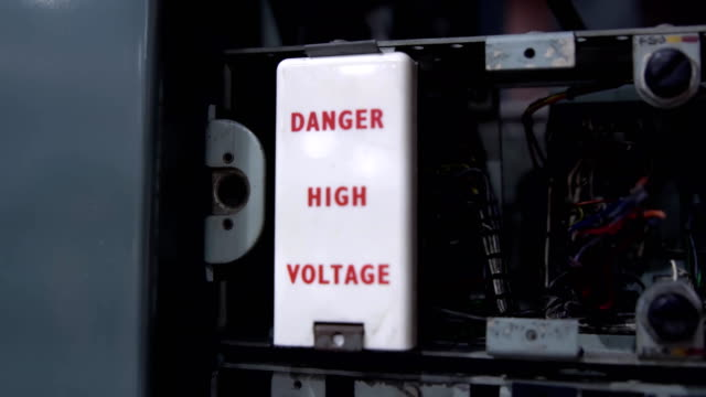 Danger high voltage sign. Old telephone dial station Danger high voltage sign. Old telephone dial station. 1960s high voltage sign stock videos & royalty-free footage