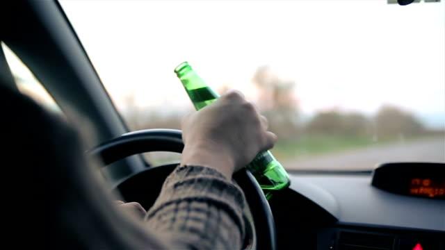 vídeos de stock e filmes b-roll de danger on the road caused by drunken drivers,b roll - bêbedo