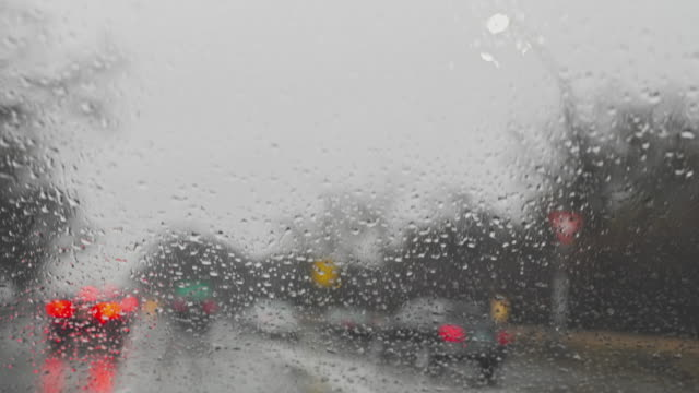Dangerous driving on a highway in a rainy weather