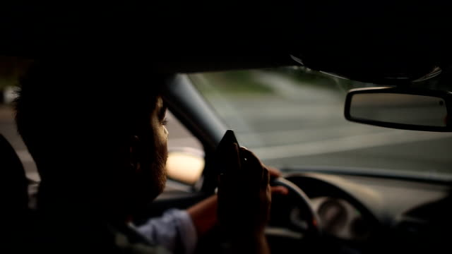 Dangerous driving while writing SMS text message video