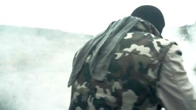 Dangerous Masked Man with Weapon Walking smoke video