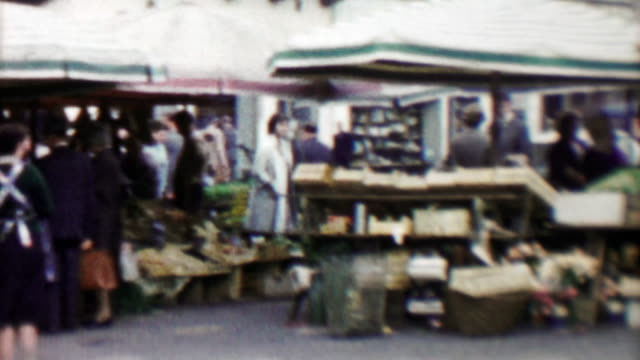 1961: Danish street open air farmers market merchants selling food.