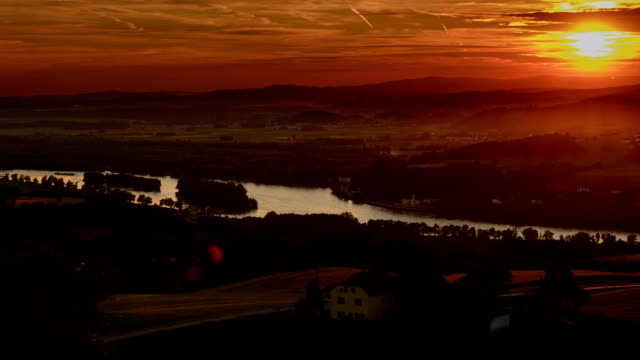 Danube river farmland and villages sunset time lapse video
