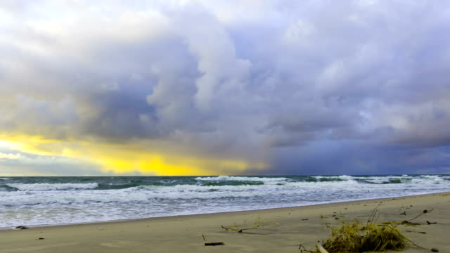 Dark and dramatic storm cloud area background. Time Lapse. Epic storm tropical clouds at sunset. Coast of the Pacific Ocean. Palm beach. Timelapse 4K UHD. video