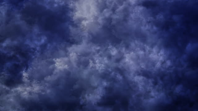 Dark blue and grey storm clouds passing overhead