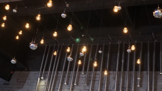 dark ceiling with hanging bright lights over