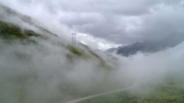 Dark cloudy valley - Aerial 4K Alpe di Maniò, Bedretto, Ticino - Switzerland Drone DJI Phantom 4 PRO 4K - 29.97fps - 10 sec. mountains in mist stock videos & royalty-free footage