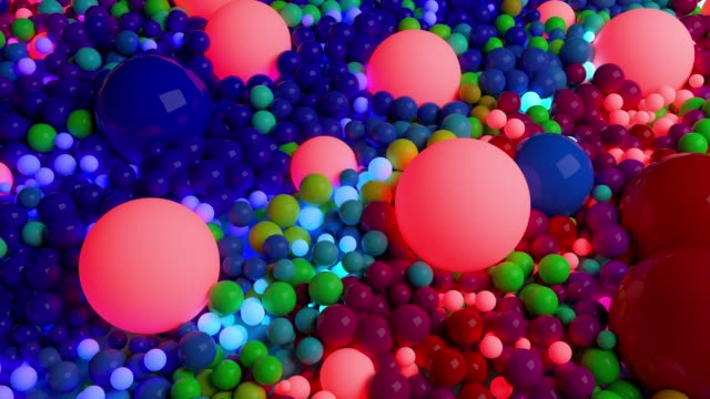 dark composition with colorful balls that cover the surface, some of which glow. 3d in 4k abstract background with flowing animation of spheres video