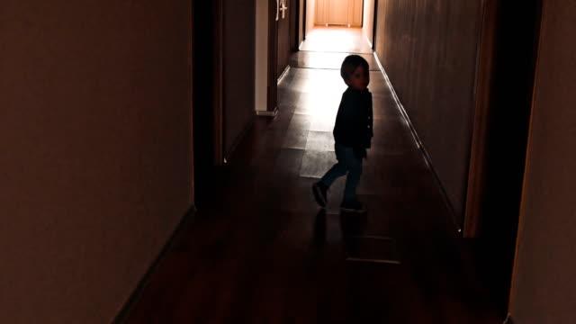 dark corridor with cabinet doors and window - bułgaria filmów i materiałów b-roll