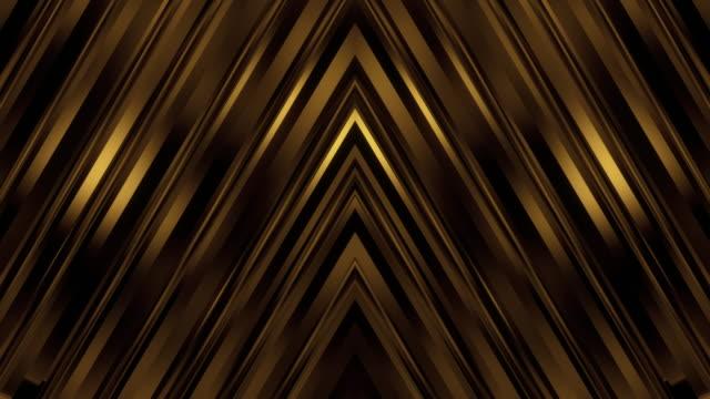 koyu zarif altın simetrik duvar arka plan döngüsü - altın metal stok videoları ve detay görüntü çekimi