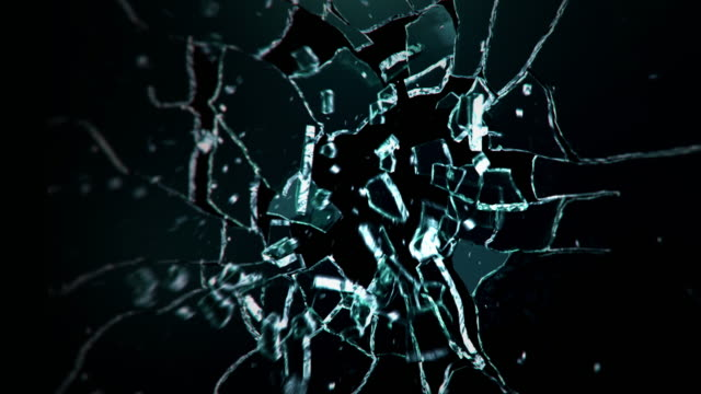Dark glass wall explosion. Bullet exploding a glass pane video