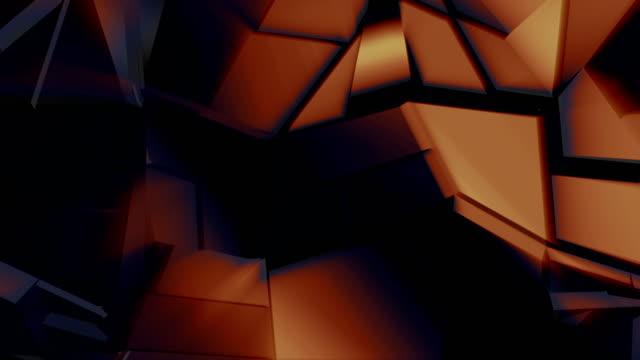 Dark golden polygonal broken shapes fluctuate seamless loop. 3D animation. video
