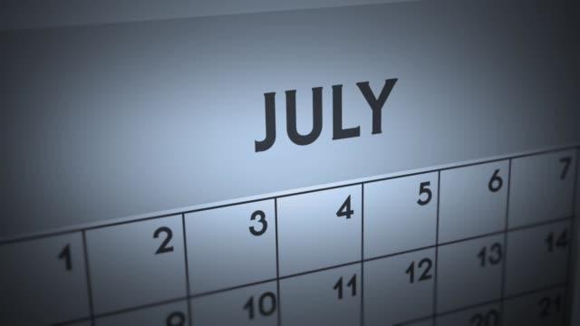 dark ominous calendar page animation - july - luglio video stock e b–roll