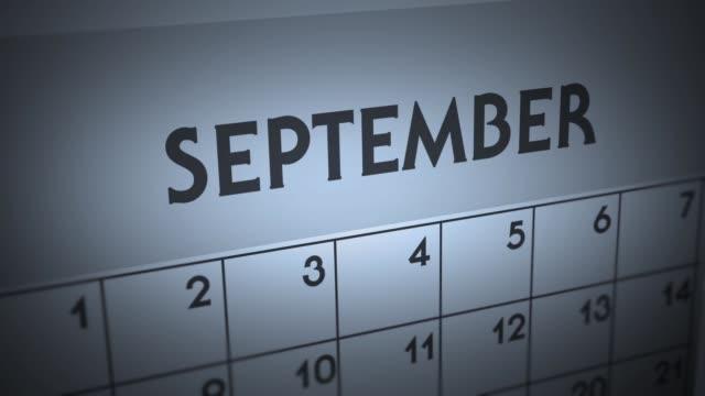 vídeos de stock e filmes b-roll de dark ominous calendar page animation - september - setembro