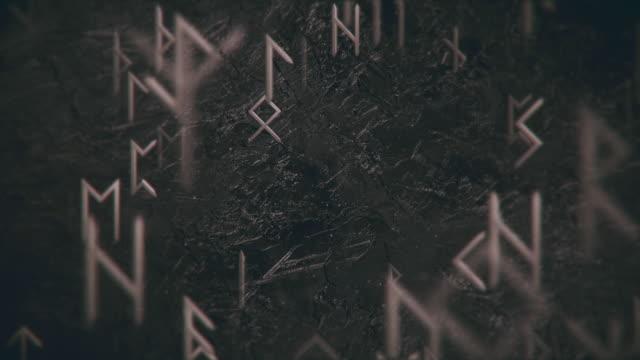 vidéos et rushes de fond de mouvement de symboles runiques foncés - mystère