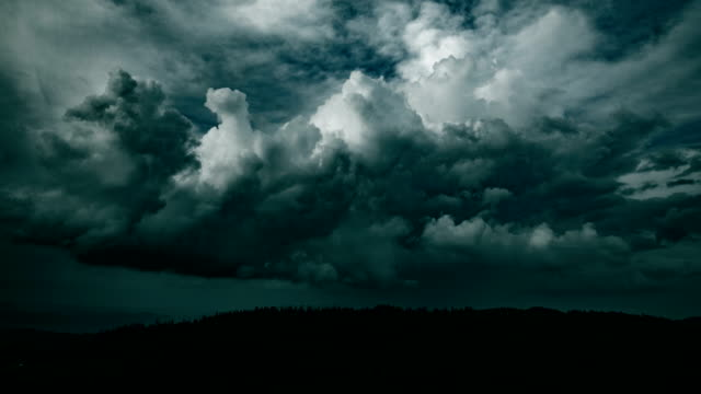 dark storm cloud in mountains - monsone video stock e b–roll