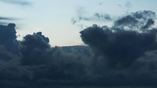 dark storm cloud rolling in the rainy season, huge of heap cloud moving pass time lapse