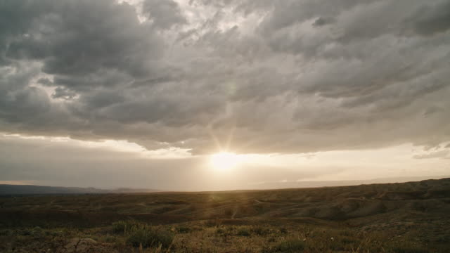 Dark Storm Clouds Roll Across a High Desert Landscape in Western Colorado at Sunset