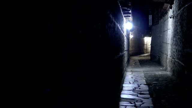 Dark urban city stone pavement alley at night Dark urban city stone pavement alley at night alley stock videos & royalty-free footage