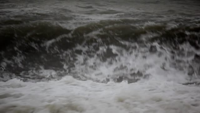 Dark water of sea in storm, dull weather video