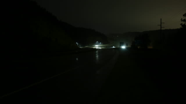 Dark winding wet freeway - 4K time lapse video