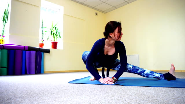 Dark-haired European girl doing warm up in spacious fitness room video
