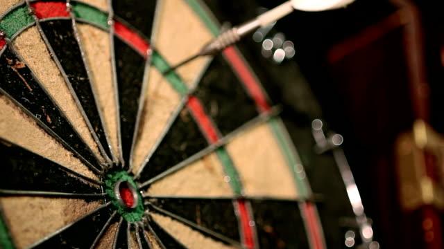 darts hitting a dartboard video
