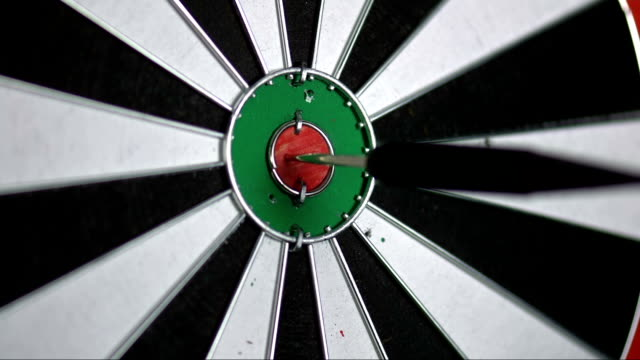 SLO MO darts point hitting the inner bull video