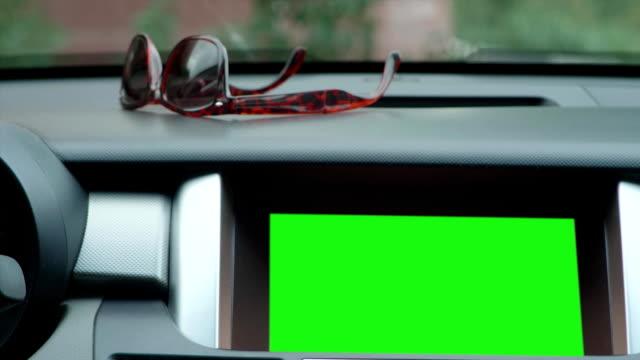 Dashboard - head unit, digital radio, navigation touch screen in the modern car. Green screen display video