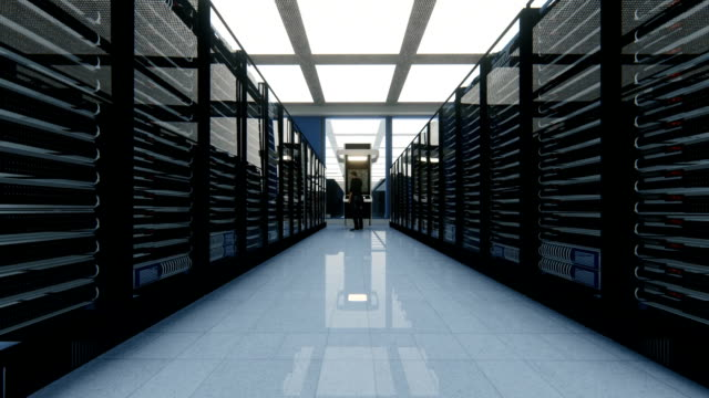 Data center, high tech server room with engineer talking on mobile phone Data center, high tech server room with engineer talking on mobile phone server room stock videos & royalty-free footage