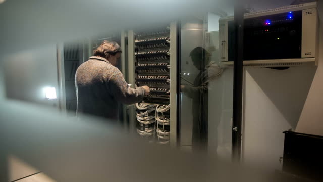 IT data center servers People working in computer server room data center. mainframe stock videos & royalty-free footage